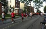 Runners running down State Street in Media's Five Mile Race